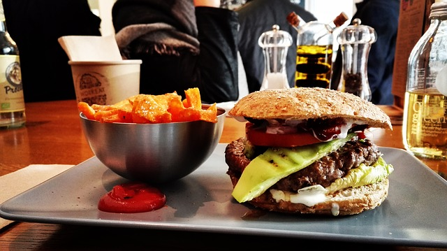 hamburger and fries on a plate in a restaurant